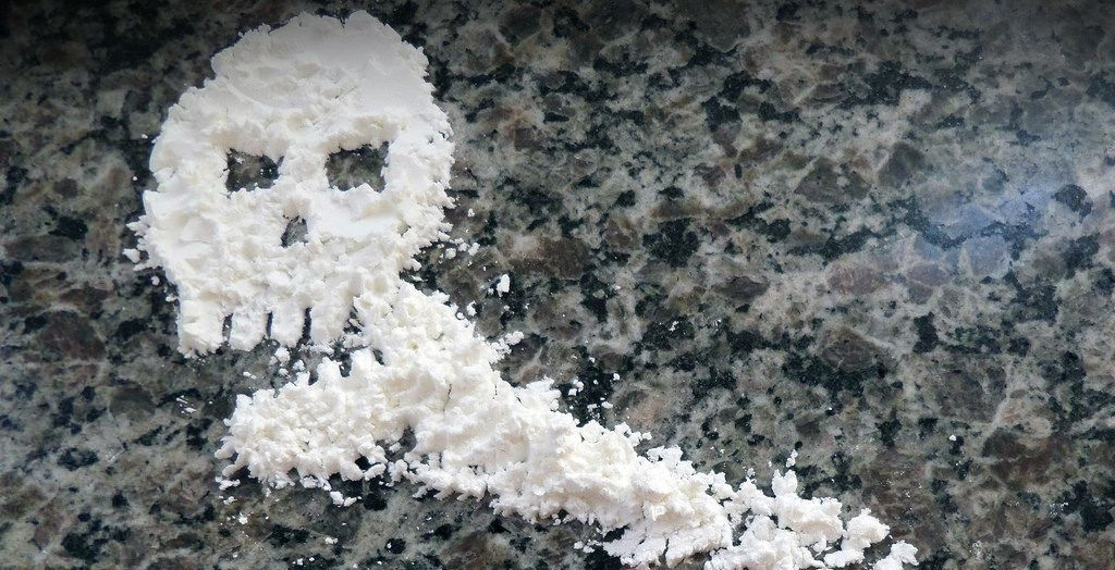 cocaine on table in the shape of the skull