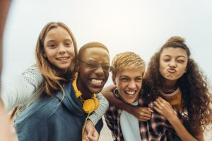 Adolescent Mental Health Treatment Facility four teens playfully taking a selfie
